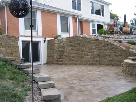 Elaborate stone patio with walls and stairs